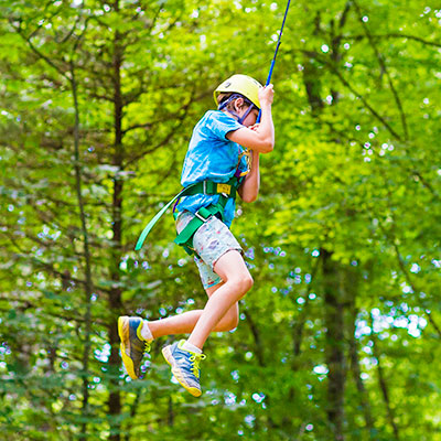 boy on zipline harness