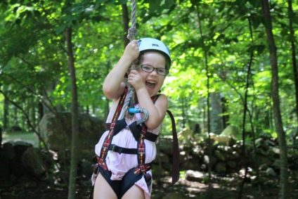 young girl zip lining