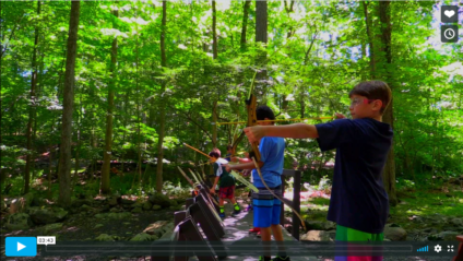 campers shooting archery
