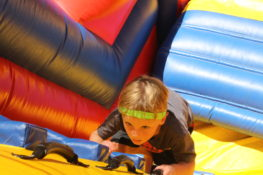 boy climbing inflatable rock climbing wall
