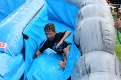 boy sliding down water slide